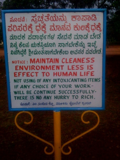 Strangely, the kannada part of this sign is perfect without any mistakes.